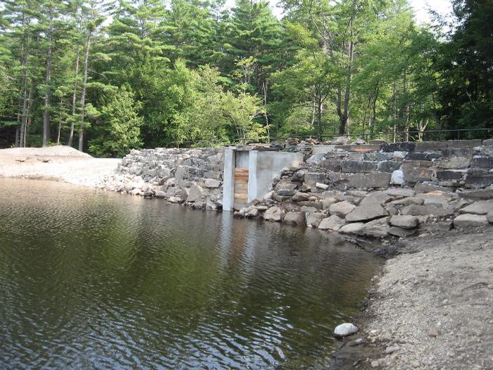 Ruggles pond dam rehabilitation wendell ma clayton d for Pond dam design